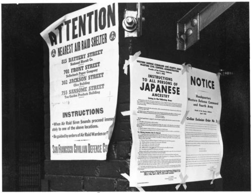 San Francisco, California. On a brick wall beside air raid shelter poster, exclusion orders were posted at First and Front Streets directing removal of persons of Japanese ancestry from first San Francisco section to be affected by evacuation. The order was issued April 1, 1942, by Lieutenant General J.L. DeWitt, and directed evacuation from this section by noon on April 7, 1942.