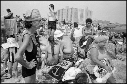 USA. NYC. Coney Island. 1977. Crowds of people clustered together on the beach.